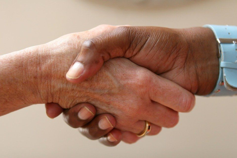 Image of people shaking hands in business networking
